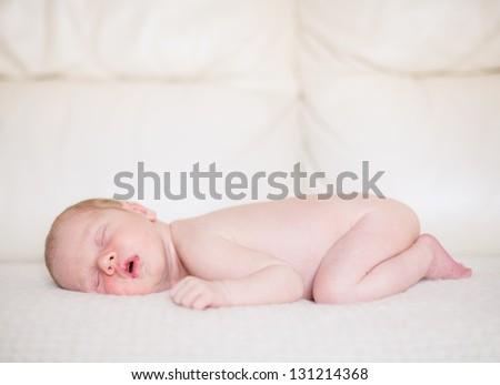 11 days young baby. Sleeping baby boy. - stock photo