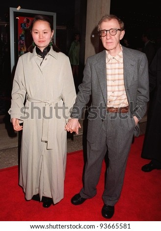 "05DEC97: Actor/director WOODY ALLEN & girlfriend SOON LI at world premiere of his new movie, ""Deconstructing Harry"" in Century City, Los Angeles."