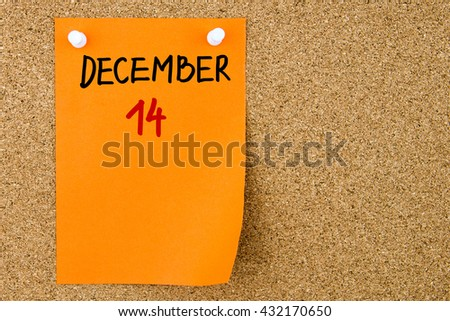 14 DECEMBER written on orange paper note pinned on cork board with white thumbtacks, copy space available - stock photo
