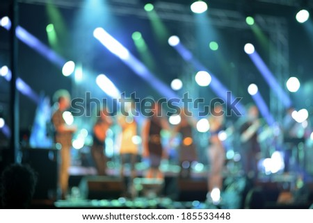 Defocused  abstract background lights with silhouettes of singer - stock photo