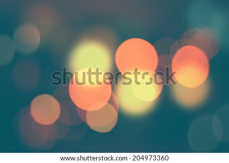 Defocused city night bokeh abstract background cyan filtered. - stock photo