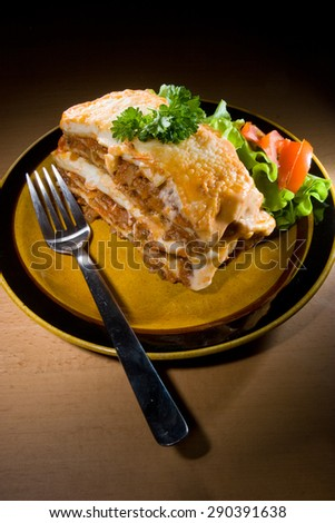 Delicious lasagna portion - stock photo