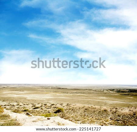 desert  against a blue sky with clouds