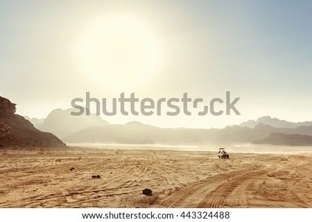 Desert Landscape of Wadi Rum in Jordan with a tourist car.