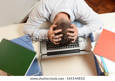 Desperate Overwhelmed Stressed Student  or Businessman at Work  - stock photo