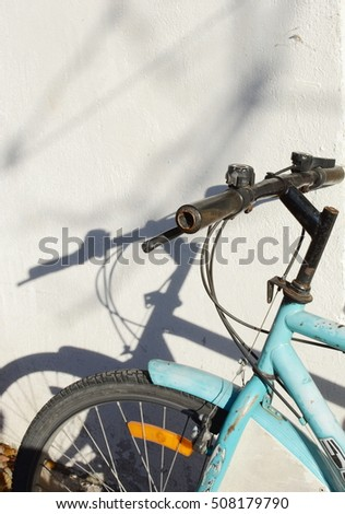 Detail of a Vintage Bicycle Handlebar with a shadow on the wall..