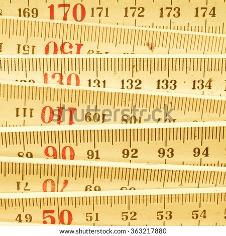 Detail of a wooden metric carpenter ruler vintage - stock photo