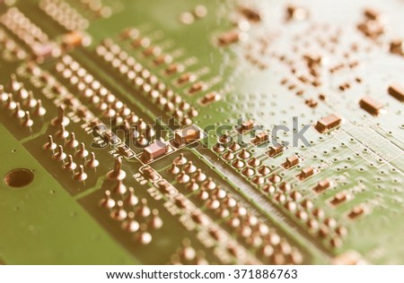 Detail of an electronic printed circuit board - selective focus vintage