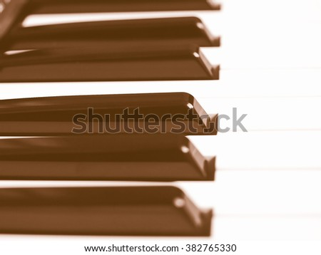 Detail of black and white keys on music keyboard - selective focus vintage - stock photo
