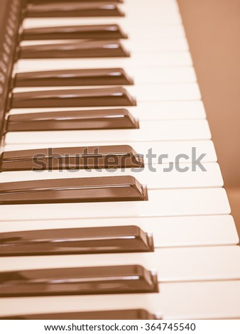 Detail of black and white keys on music keyboard vintage