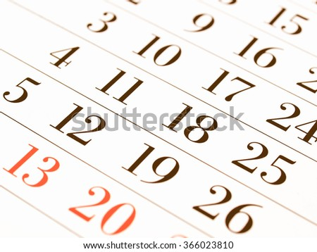 Detail of dates on a calendar page vintage - stock photo
