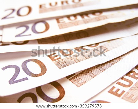 Detail of Euro money banknotes coins - European currency vintage