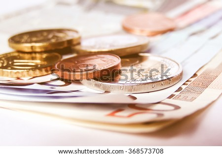 Detail of Euro money banknotes coins - European currency vintage - stock photo