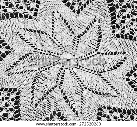 Detail of hand-crocheted tablecloth with star details - stock photo