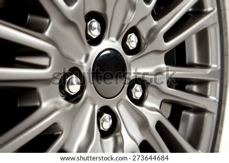 Detail of the aluminum wheel of a modern sports car. Aluminum wheel.   - stock photo
