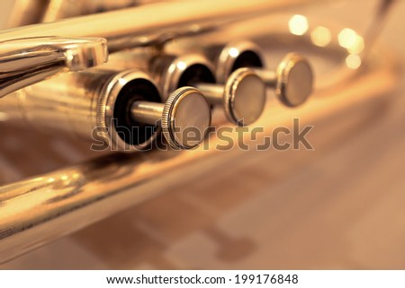 Detail of trumpet closeup in golden tones - stock photo
