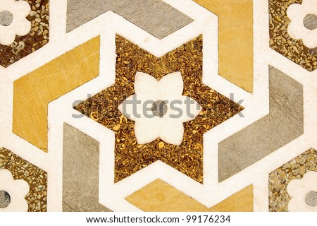 Details of polished marble surface is covered by stone inlay. - stock photo