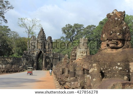Deva and asura statues holding nagas, the southern gate of Angkor Thom