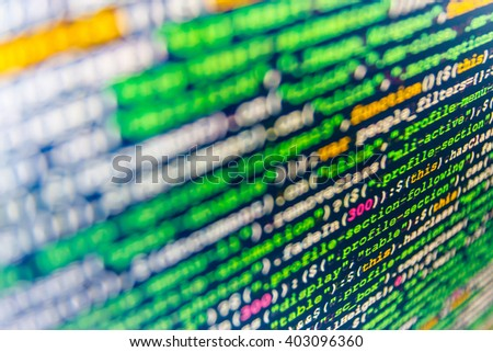 Developer working on software codes in office. Website development. Software development. Source code photo. Programmer workplace. Programming code on computer screen. Monitor photo.   - stock photo