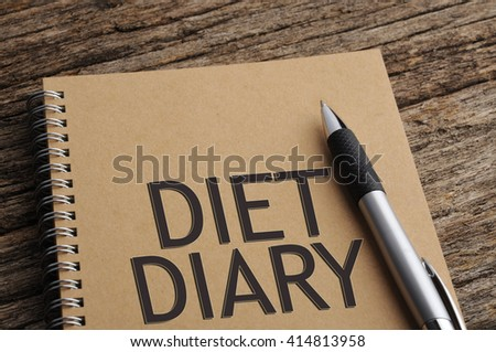 """""""DIARY DIET"""" Word on Notebook with Pen On Wooden Background - stock photo"""