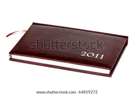2011 diary isolated on white - stock photo