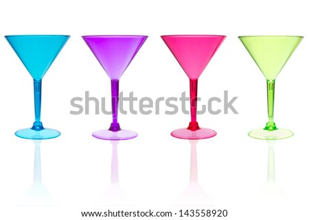 4 different color martini cocktail glasses on white - stock photo