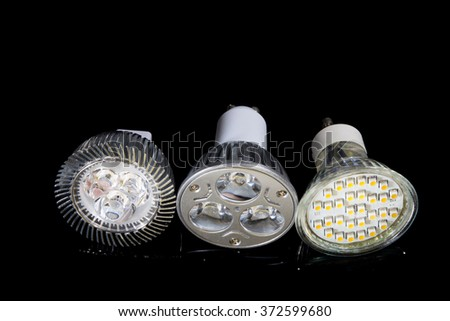 3 different types of LED lamp isolated on black background. - stock photo