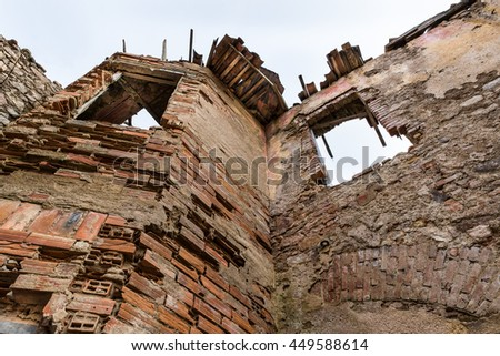 Dilapidated house, earthquake, rubble and debris - stock photo