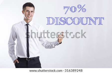 70% DISCOUNT - Young smiling businessman pointing on text