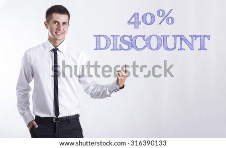 40% DISCOUNT - Young smiling businessman pointing on text