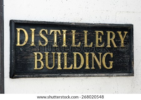 """Distillery Building"" sign indicating where the stills are for turning the grains into alcohol are located."