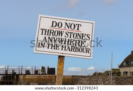 """Do Not Throw Stones Anywhere in the Harbour"" Sign in the Seaside Village of Porlock Weir in Exmoor National Park on the North Coast of Somerset, England, UK"