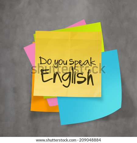 """do you speak english"" text on sticky note paper on wall texture - stock photo"