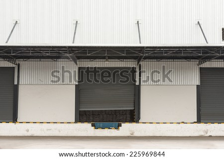 Dock. Warehouse Building with Gates. Business and Logistics  - stock photo
