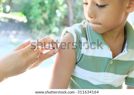 doctor vaccinating a child - stock photo