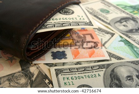 100 dollar bill  in leather brown purse on money background