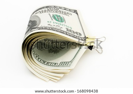 100 dollar bill with a clip on a white background