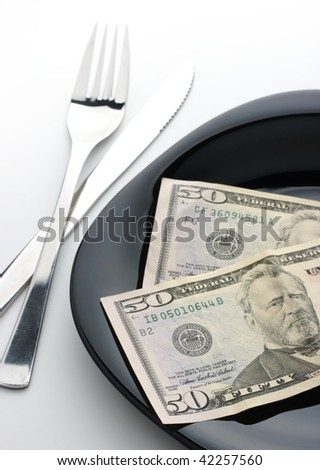 50 dollar bills on plate with fork and knife
