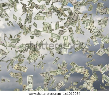 1,5,10,20,50,100 dollar bills rain. - stock photo