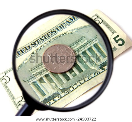 5 dollars and 5 rubles under magnifying glass