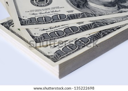 100 dollars bills in the stack,heap of dollars. money background