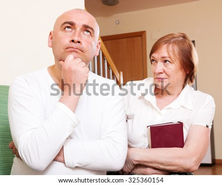 Domestic quarrel between adult son and senior mother - stock photo
