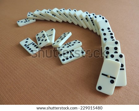 Domino effect. The Falling Domino Prinsiple. The Domino principle. The game of dominoes. - stock photo