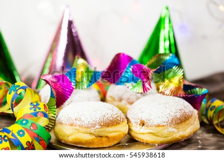 Donut for carnival, New Year's Eve, colorful hats, streamers
