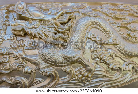 Dragon statue in Chinese Shrine. - stock photo
