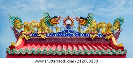 2 dragons sculpture which decorate on a roof of Chinese temple