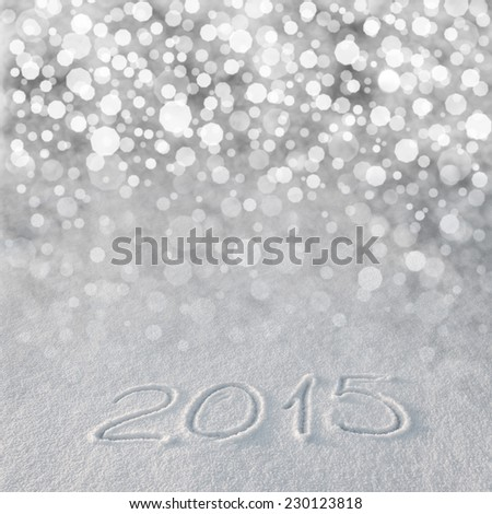 2015 draw on snow and magic holiday bokeh - stock photo