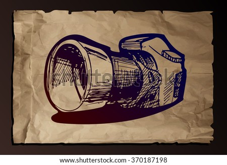drawing of camera stylized as engraving on old paper background, - stock photo