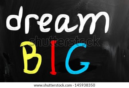 """dream big"" handwritten with white chalk on a blackboard - stock photo"