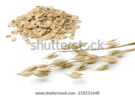 Dried oat and seeds on white background - stock photo